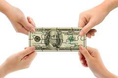 Handen en geldraadsel Stock Foto's