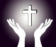 Handen en het kruis Stock Foto's