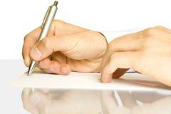 Handen en pen Stock Foto's