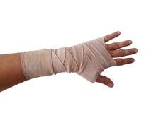 handen förbinder den isolerade assistentmannen Arkivbild