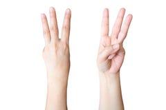 handen gör tecken tre Fotografering för Bildbyråer