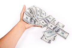 Handen ger pengar Fotografering för Bildbyråer