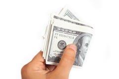 Handen ger pengar Royaltyfri Bild