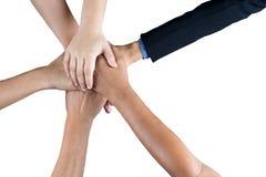 Handen grupperar tillsammans Arkivfoto