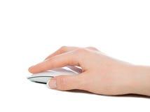 Handen klickar på den moderna datormusen Fotografering för Bildbyråer