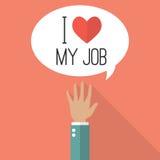Handen lyftte med ord som jag älskar mitt jobb på anförandebubbla Royaltyfri Foto