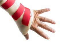 Handen med handleden och tummen spjälkar Arkivbilder