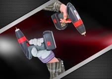 handen met boren met rood en metaalachtergrond royalty-vrije stock foto