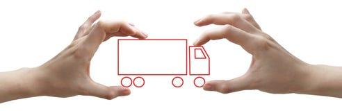 Handen met concepten rode vrachtwagen Stock Foto's