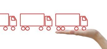 Handen met concepten rode vrachtwagens Stock Fotografie