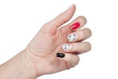 Handen met de manicure van het kleurennagellak Stock Foto