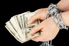 Handen met dollars in ketting stock foto's