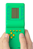 Handen met elektronisch tetrisspel Stock Afbeeldingen