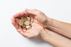 Handen met muntstukken Stock Foto