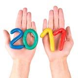 Handen met plasticinecijfers Stock Foto