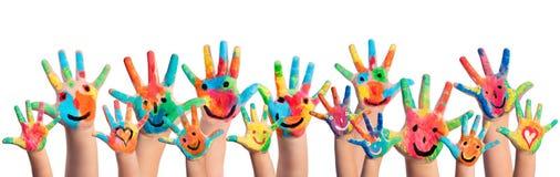 Handen met Smileys worden geschilderd die Stock Afbeelding