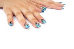 Handen met spijkerart. Stock Fotografie