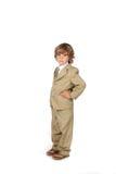 Handen op de jongen van het heupenkostuum Stock Fotografie