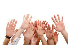 Handen op groepsmensen die op wit worden geïsoleerd0 Stock Fotografie
