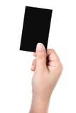 Handen rymmer affärskortet royaltyfri fotografi