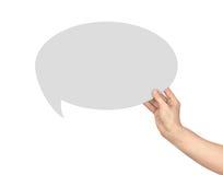 Handen rymmer en dialog royaltyfri fotografi