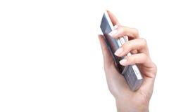 Handen rymmer mobiltelefon Royaltyfria Bilder