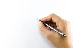 Handen skriver på anteckningsboken Royaltyfria Bilder