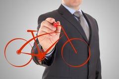Handen tecknar en cykel fotografering för bildbyråer