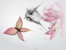 Handen tecknar fjärilen Arkivfoton