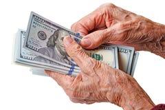 Handen van een oude vrouw met dollars royalty-vrije stock afbeeldingen