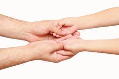 Handen van het kind en de volwassene Stock Afbeelding