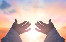 Handen van Jesus Christ-silhouet stock foto's