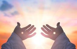 Handen van Jesus Christ-silhouet stock afbeeldingen