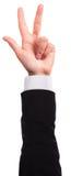 Handen visar tre isolerade fingrar Arkivfoto