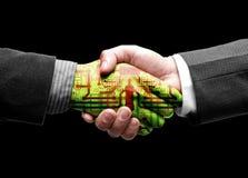 Handerschütterung mit Technologie Stockfoto