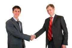 Handerschütterung von zwei Männern der Geschäftsmänner stockfoto