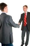 Handerschütterung von zwei Männern der Geschäftsmänner stockfotografie