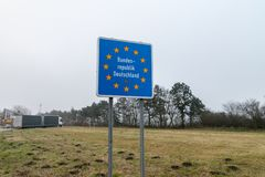Federal Republic of Germany border sign at cloudy day. Handewitt, Germany - February 14, 2019: Federal Republic of Germany border sign at cloudy day stock images