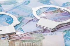 handfängslar pengar Royaltyfria Bilder