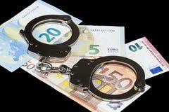 handfängslar pengar Arkivbilder