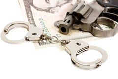 handfängslar pengarpistolen Fotografering för Bildbyråer
