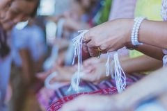 Handfasting. Selective focus on hands of Thai graduation ceremony. royalty free stock photos