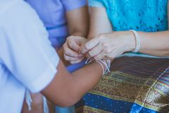 Handfasting. Selective focus on hands of Thai graduation ceremony. stock photo
