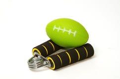 Handfattandestrengthener och spänningsboll Fotografering för Bildbyråer