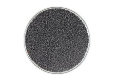 Handful of activated carbon granules Stock Image