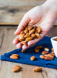 A handful of almonds in his hand Stock Photo
