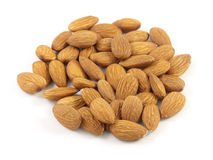 Handful of almonds is isolated on white. A handful of almonds is isolated on white Stock Photo