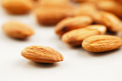 A handful of almonds on a white background Stock Image