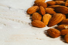 Handful of almonds on a white wooden background Stock Photography