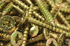 A handful of anodized screws background Royalty Free Stock Image